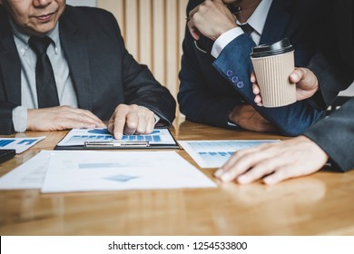 Executive team discussing the charts and graphs working in business strategy and financial plan to investment profit, discussing working analysis with financial data and marketing growth report.