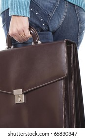 an executive woman is holding a briefcase