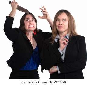 Executive woman next to angry lady with knife in her hand