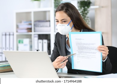 Executive woman with protective mask shows contract on videocall on laptop at the office