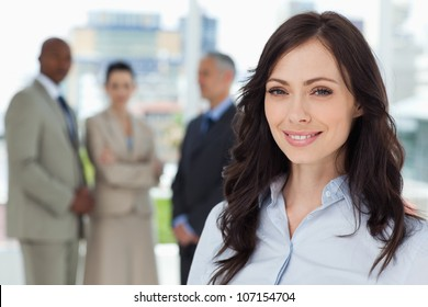Executive woman showing a beaming smile in front of the camera