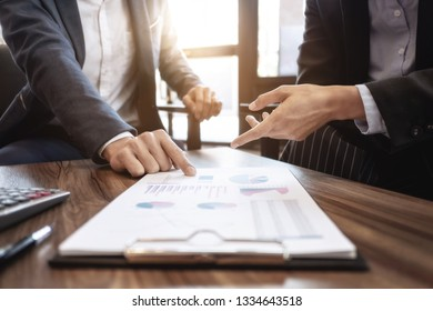 Executives coperate, Business People explaining a valuation data in modern office.