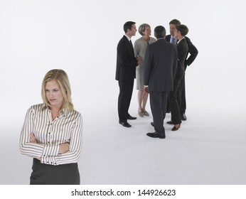 Executives in group with businesswoman left out