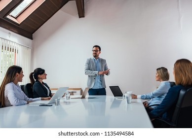 Executives having a meeting in conference room.