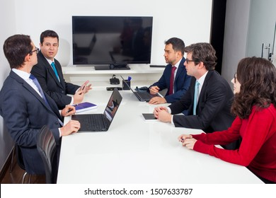 Executives and lawyers in business meeting