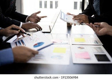 Executives and managers are meeting in a conference room, on the table there are some documents about the company's finances, managers are discussing financial information with the management.