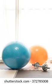 Exercise ball and dumbbell