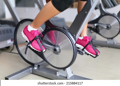 Exercise bike with spinning wheels.