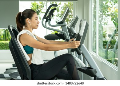 Exercise bike workout at fitness gym of woman taking weight loss with machine aerobic for slim and firm healthy in the morning.