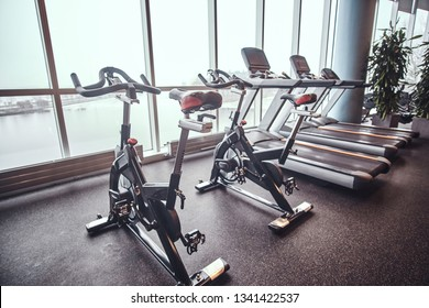 Exercise bikes and treadmills in the fitness center. Sport, fitness, health.