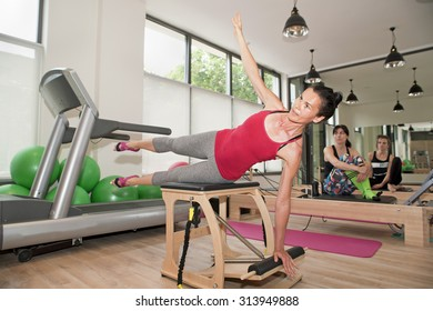 Exercise on pilates chair at gym