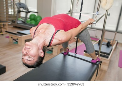 Exercise on pilates device cadillac at gym