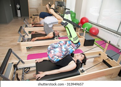 Exercise on pilates device reformer at gym