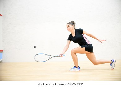 Exercise on the righthand in squash, girl athlete