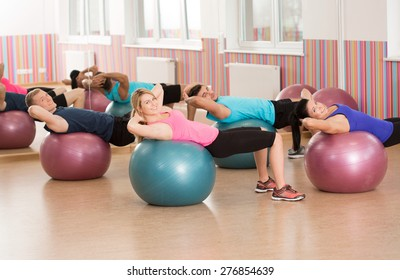 Exercise with swiss ball during fitness classes