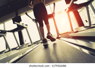 Exercise treadmill cardio running workout at fitness gym of woman taking weight loss with machine aerobic for slim and firm healthy in the morning Soft focus.