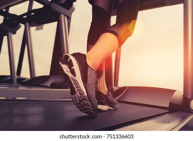 Exercise treadmill cardio running workout at fitness gym of woman taking weight loss with machine aerobic for slim and firm healthy in the morning, Athlete builder muscles lifestyle.