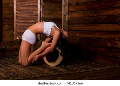 exercise, workout in yoga.A girl practicing yoga with a wheel.practice helps keep the body healthy. Supplement blood circulation Make good health. Copy space