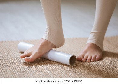 Exercises from edema during pregnancy. Young Pregnant woman removes leg swelling with a foot massage