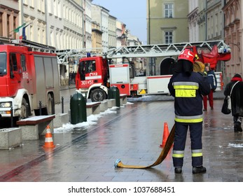 Exercises fire brigade in the old part of the city in the winter. Elimination of fire and natural disasters. Emergency response service. Equipment. Europe. Poland. Krakow. February 2018.