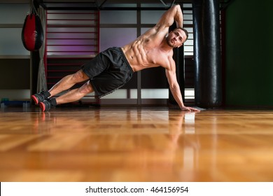 Exercising Abs Side Plank Hip Raise Abdominal Crunch In Fitness Club