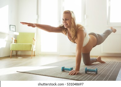 Exercising beautiful pregnant woman at home