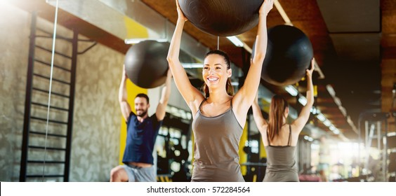 Exercising at gym with pilates ball.