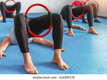 Exercising in gym with pilates rings