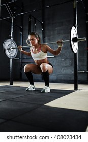 Exercising with heavy barbell