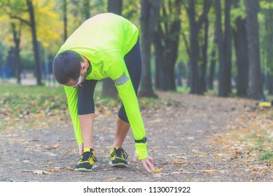 Exercising / jogging injury during workout in the park.