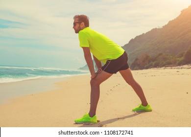 Exercising on a tropical sandy beach near sea / ocean.