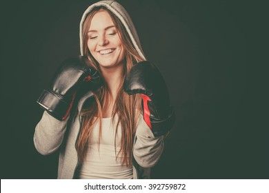 Exercising prepare for fight. Sportsmanship and strong body. Happy young woman wear sportswear boxing with opponent. Sport and fitness healthy lifestyle.