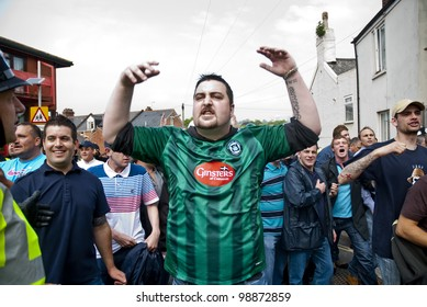 EXETER - APRIL 30: Plymouth Argyle fans shout at rival Exeter City supporters at the League 1 match between Exeter City FC and Plymouth Argyle FC on April 30, 2011 in Exeter, UK.