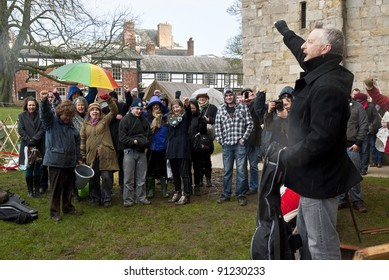 EXETER - DECEMBER 16: Billy Bragg gives a rally cry to the audience at the Occupy Exeter camp at Exeter Cathedral at the Occupy Exeter Camp at the Occupy Exeter camp on December 16, 2011 in Exeter, UK