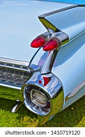 Exeter, Devon / England - 5/10/2019: Classic car show. Cadillac Eldorado American sports saloon with the definitive sharkfin tail fins to the rear. Close up detail of one fin with tail lights.