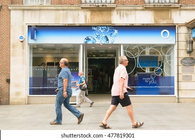 Exeter, Devon, England, UK - 24 August 2016: Pedestrians pass O2 shop on High street. O2 is the official sponsor of the England Rugby team.