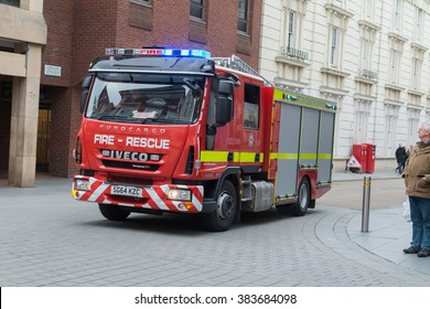 EXETER, DEVON, ENGLAND, UK: 27 FEBRUARY 2016 - Fire Engine responding to an emergency driving with sirens and blue lights through the centre of Exeter