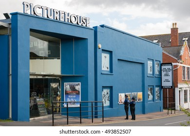 Exeter, Devon, England, UK - 30 September 2016: Unidentified policemen look at what films are on at Exeter Picturehouse. The cinema celebrates it's 20th anniversary on October 11, 2016.