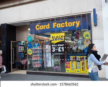 EXETER, DEVON, UK - December 03 2019: Card Factory store front on 247 High Street Exeter.  Shop window is advertising Black Friday offers