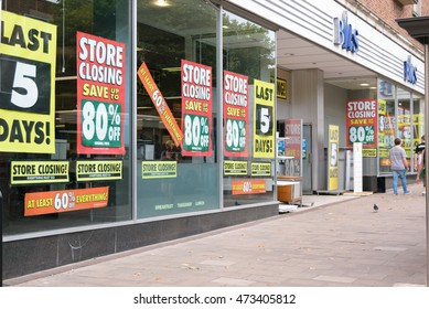 Exeter, Devon, United Kingdom - August 24, 2016: People walk by BHS (British Home Stores) store on Fore Street in Exeter. There are signs that show the store is closing in 5 days.