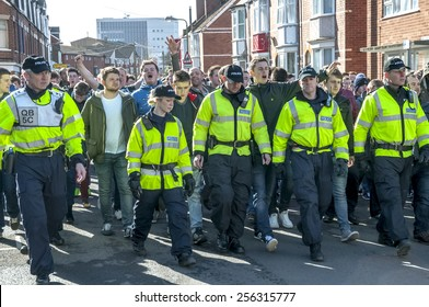 EXETER, ENGLAND - FEBRUARY 21, 2015: Devon and Cornwall Police escort Plymouth Argyle FC football fans at the League 2 football match between Exeter City FC and Plymouth Argyle FC