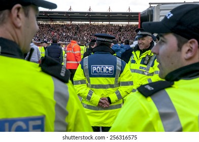 EXETER, ENGLAND - FEBRUARY 21, 2015: Devon and Cornwall Police wait for football fans during the police operation at the League 2 football match between Exeter City FC and Plymouth Argyle FC