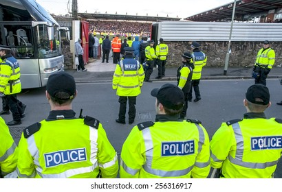 EXETER, ENGLAND - FEBRUARY 21, 2015: Devon and Cornwall Police prepare for Plymouth Argyle football fans to leave during the League 2 football match between Exeter City FC and Plymouth Argyle FC