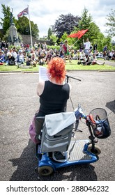 EXETER, ENGLAND - JUNE 13, 2015: Katie Moudry adresses the audience at  the Devon 'End Austerity NOW!' Rally in Northernhay Gardens, Exeter on June13th, 2015 in Exeter, UK
