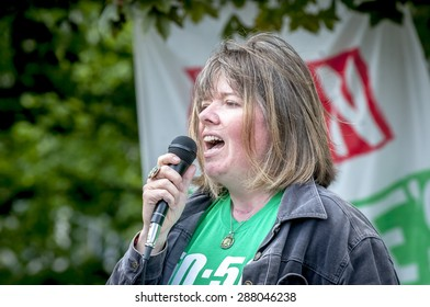EXETER, ENGLAND - JUNE 13, 2015: Diana Moore giving a speech during the Devon 'End Austerity NOW!' Rally in Northernhay Gardens, Exeter on June13th, 2015 in Exeter, UK