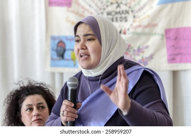 EXETER, ENGLAND - MARCH 7, 2015: Nrvan Zowal addresses the audience at Exeter Mosque during the Walk for Peace through the city of Exeter to celebrate International Women's Day