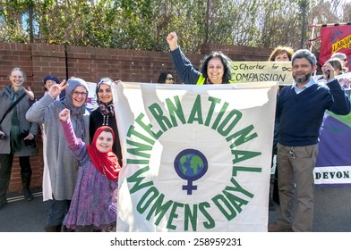 EXETER, ENGLAND - MARCH 7, 2015: Devon women celebrate at Exeter Mosque during the Walk for Peace through the city of Exeter to celebrate International Women's Day.