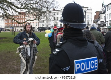 EXETER - FEBRUARY 11: A Devon & Corwall policeman has a discussion with Occupy Exeter activist dropping rubbish during Occupy Exeter's leaving the green in Exeter  on February 11, 2012 in Exeter, UK