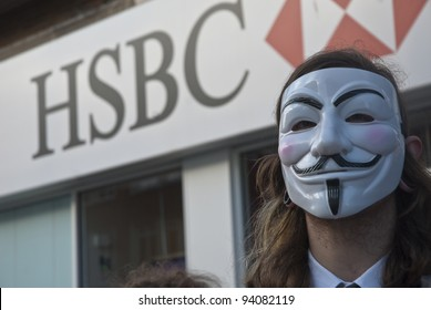 EXETER - JANUARY 28: Occupy Exeter activist wearing a Guy Fawkes mask campaigning outside the Exeter branch of HSBC bank  on January 28, 2012 in Exeter, UK
