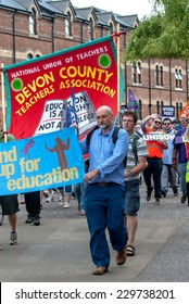 EXETER - JULY 10: A man from the National Union of Teachers walks with protesters during the public sector workers national day of action in Exeter City Centre on July 10,  2014 in Exeter, Devon, UK